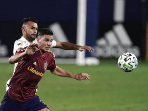 Real Salt Lake's Damir Kreilach, front, and Los Angeles Galaxy's Giancarlo Gonzalez chase the ball during the first half of an MLS soccer match, Sunday, Nov. 1, 2020, in Carson, Calif. (AP Photo/Jae C. Hong)