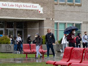 (Francisco Kjolseth | The Salt Lake Tribune) East High lets out on a rainy day on Monday, April 26, 2021. Salt Lake City School District has seen an improvement in grades, including at its high schools, since students have begun returning for in-person learning this spring.