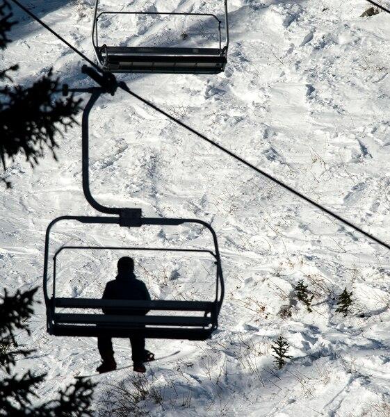 (Steve Griffin | The Salt Lake Tribune) A snowboarder rides a lift at Brighton ski area in Salt Lake City Monday January 1, 2018.