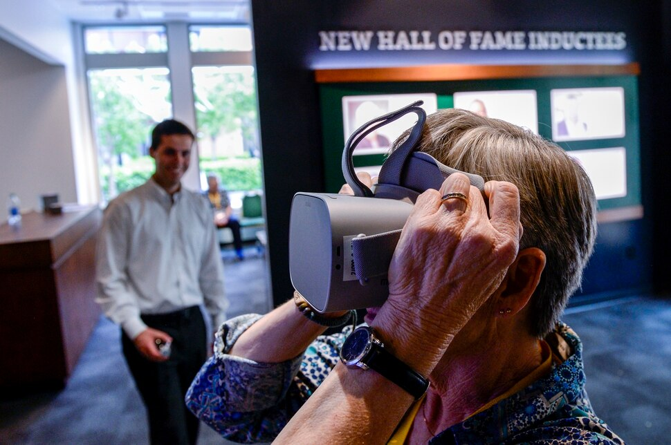 (Leah Hogsten | The Salt Lake Tribune) Susan Rydalch, a Utah Sports Hall of Fame coach inductee of 2007 takes a video interactive luge ride while touring the new Utah Sports Hall of Fame museum, Wednesday, May 15, 2019. Rydalch, a former volleyball coach at Tooele High School is honored by the sports hall of fame, along with her husband Ron Rydalch, a former Bears football player who was inducted in 2019.