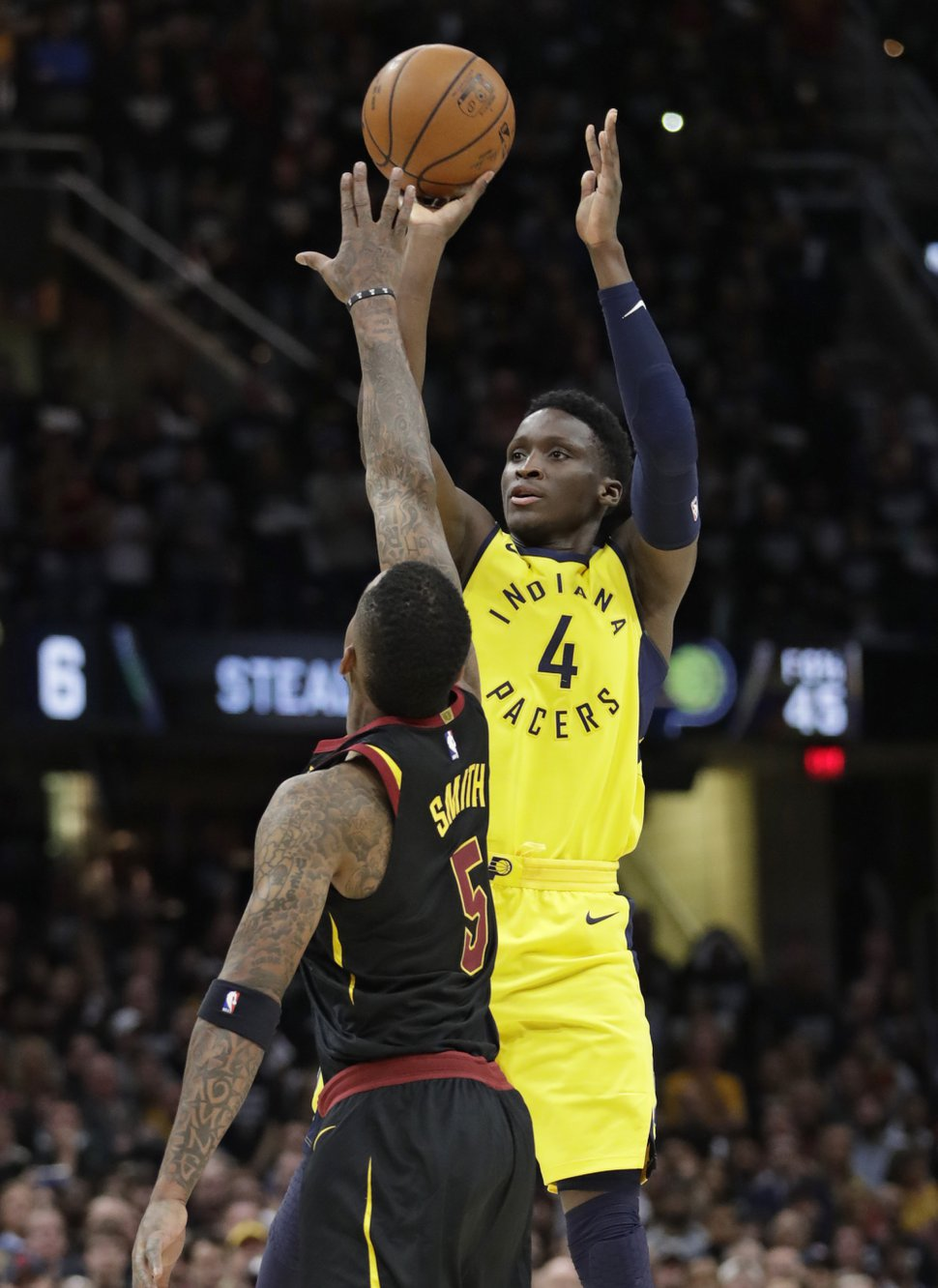 Indiana Pacers' Victor Oladipo (4) shoots over Cleveland Cavaliers' JR Smith (5) in the second half of Game 7 of an NBA basketball first-round playoff series, Sunday, April 29, 2018, in Cleveland. (AP Photo/Tony Dejak)