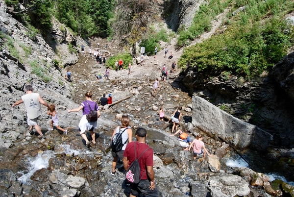 (Brian Maffly | The Salt Lake Tribune) A typical summer Saturday at Big Cottonwood Canyon's Donut Falls sees hundreds of visitors who make the 1-mile hike in Cardiff Fork. Excessive recreational use in the canyons east of Salt Lake City now threatens the very resources that make the canyons worthy places to tap for drinking water and enjoy nature.