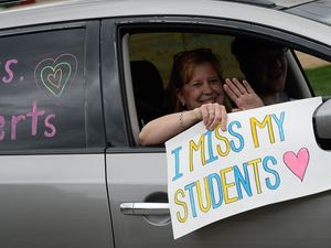 "(Francisco Kjolseth  |  The Salt Lake Tribune) The Highland Park Elementary PTA hosts a ""teacher parade,"" on Friday, May 1, 2020, in Salt Lake City as teachers and staff drive along most of the school boundary streets to celebrate teachers and students during the coronavirus pandemic which closed down schools."