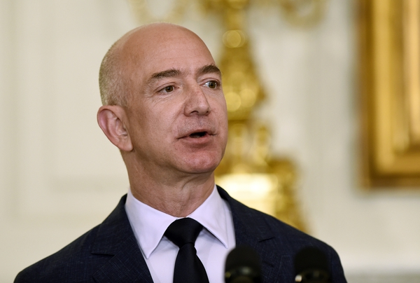 FILE - In this May 5, 2016, file photo, Jeff Bezos, the founder and CEO of Amazon.com, speaks in the State Dining Room of the White House in Washington. In a milestone announced March 6, 2018, Bezos has become the first person to amass a fortune surpassing $100 billion in Forbes magazine's annual ranking of the world's moguls. (AP Photo/Susan Walsh, File)