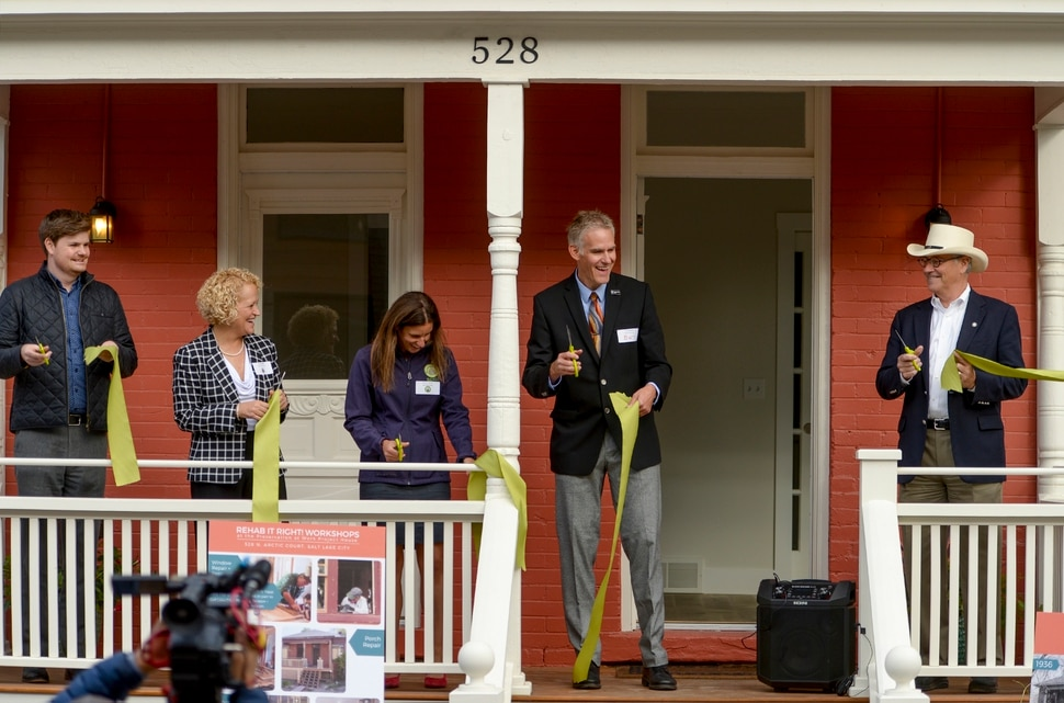 Leah Hogsten | The Salt Lake Tribune l-r Salt Lake City council member Chris Wharton, mayor Jackie Biskupski, RDA project coordinator Susan Lundmark, Preservation Utah executive director Kirk Huffaker and project architect Dave Richards celebrate the completion of the newly completed Preservation at Work Project House at 528 N. Arctic Court in Salt Lake City's historic Marmalade neighborhood, Thursday, October 11, 2018.