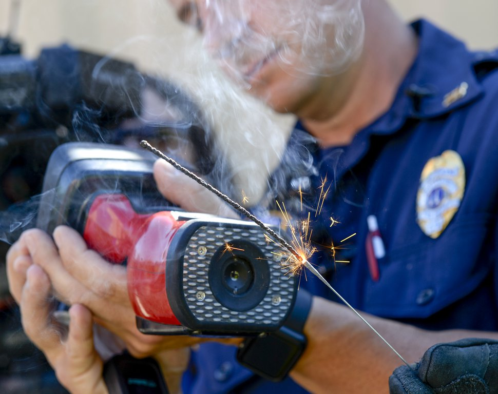 (Leah Hogsten   The Salt Lake Tribune) Salt Lake City Fire Department captain Adam Archuleta uses a thermal imaging camera to measure the high amount of heat that sparklers can produce, July 3, 2019, despite the fact that sparklers are handled by children every year. Salt Lake City firefighters staged a demonstration to illustrate how hot lit sparklers can get and to urge parents to supervise their use by children ahead of the Fourth of July week celebration.