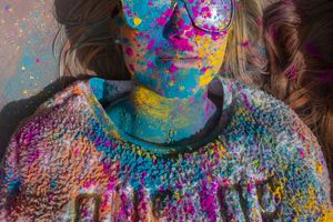 (Rick Egan  |  The Salt Lake Tribune)    Kimberly Woolsey, from Gilbert , Arizona, takes a break from the crowd and lies not the ground, during the Holi Festival of Colors celebration at the Sri Sri Radha Krishna Temple in Spanish Fork, Saturday, March 30, 2019.