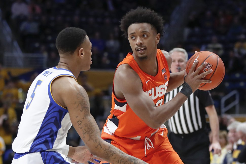 Syracuse's Elijah Hughes, right, looks to pass around Pittsburgh's Au'Diese Toney (5) during the first half of an NCAA college basketball game, Wednesday, Feb. 26, 2020, in Pittsburgh. Syracuse won 72-49.(AP Photo/Keith Srakocic)
