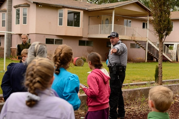 Trent Nelson | The Salt Lake Tribune Colorado City Town Marshal Sam Johnson orders young FLDS children to leave the property of a home being taken over by the UEP Trust in Colorado City, Ariz., Wednesday, May 10, 2017.