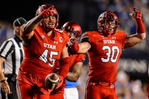 (Trent Nelson | The Salt Lake Tribune)  Utah Utes defensive tackle Filipo Mokofisi (45) celebrates a turnover as BYU hosts Utah, NCAA football in Provo, Saturday, Sept. 9, 2017.