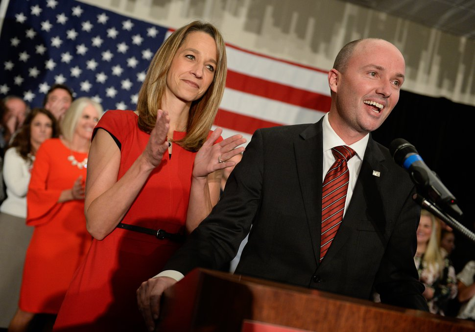 (Francisco Kjolseth | The Salt Lake Tribune) Lt. Governor Spencer Cox is joined by his wife Abby as they introduce John Curtis for congress during celebrations at the Provo Marriott Hotel & Conference Center Tuesday, Nov. 7, 2017.