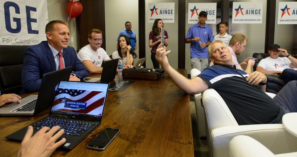 (Steve Griffin | The Salt Lake Tribune) A he waits for primary results 3rd Congressional District candidateTanner Ainge talks with his sister, Ashley Lesueur, as his father Danny Ainge holds the phone at his election night headquarters in Orem Tuesday August 15, 2017.
