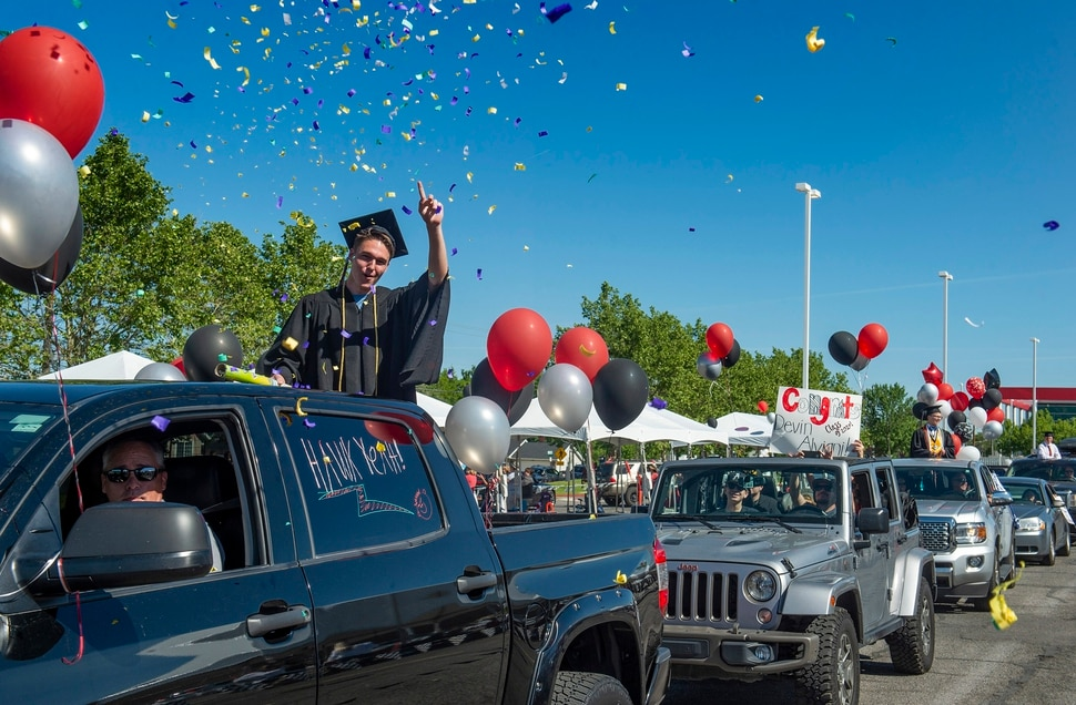 "(Rick Egan | The Salt Lake Tribune) Alta High graduate Evan Delahunty celebrates as he joins the parade of 2020 graduates in a ""drive through"" graduation ceremony at Alta High, Thursday, May 28, 2020."