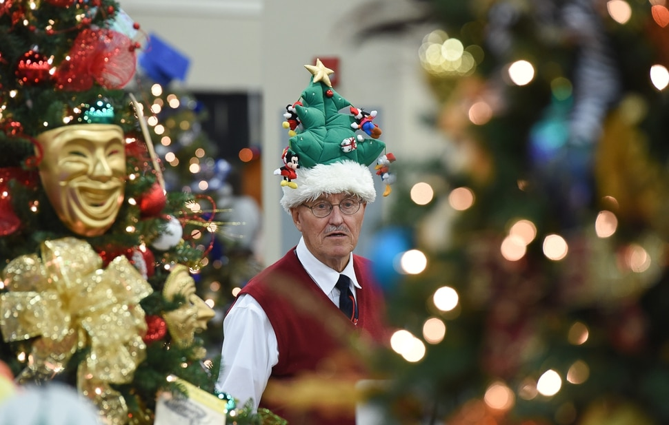 (Francisco Kjolseth | The Salt Lake Tribune) John Watkins of Clearfield gets into the spirit of the Festival of Trees at the South Towne Exposition Center in Sandy on Friday, Dec. 1, 2017.