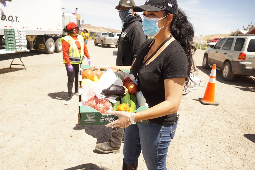 "(Zak Podmore | The Salt Lake Tribune) Sahar Khadjenoury, an employee of Utah Navajo Health Systems in Montezuma Creek, holds a food box. Nez, who described himself as a ""health nut,"" said the fresh produce was donated from farms in Arizona thanks to a partnership between Santa Cruz County Supervisor Bruce Bracker, the University of Arizona and the Navajo Nation."