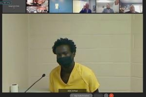 (KSL | Pool Photo) Buk Mawut Buk, 22, appears remotely for court on Friday, Oct. 15, 2021. Buk is charged with aggravated murder in the shooting death of University of Utah football player Aaron Lowe.