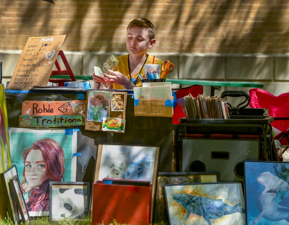 (Leah Hogsten | The Salt Lake Tribune) Mixed media artist Lucas Rohde, 14, counts his proceeds from his art sales at the Craft Lake City DIY Festival Kid Row, where children 14 and under make and sell their products. Craft Lake CityÕs DIY Festival is UtahÕs largest local, three day arts festival with over 300 artisans, DIY engineers, vintage vendors and craft food creators.