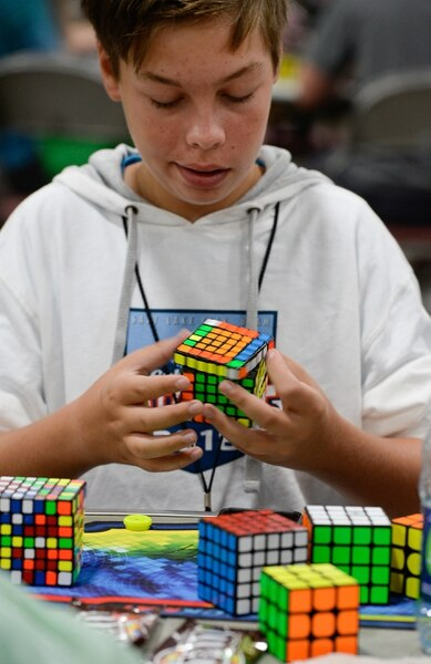 (Francisco Kjolseth | The Salt Lake Tribune) Andrew Fitzgerald, 13, of Braintree, Mass., times himself solving numerous cubes in a row as he attends CubingUSA Nationals 2018 at the Salt Palace Convention Center in Salt Lake City on Saturday, July 28, 2018.