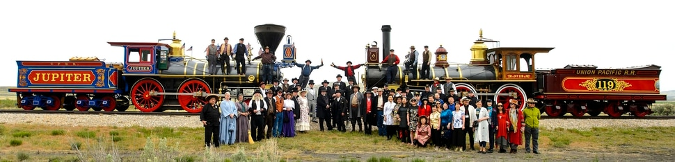(Steve Griffin | The Salt Lake Tribune) The Central Pacific Jupiter and the Union Pacific No. 119 come together for the reenactment of the historic campaign photo during ceremony for the completion of the Transcontinental Railroad at Promontory Summit in northern Utah Thursday May 10, 2018. Members of the Chinese Railroad Workers Descendants Association joined were included in the photo at right.