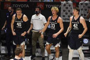 BYU players celebrate a three-point basket during the second half of an NCAA college basketball game against San Diego State, Friday, Dec. 18, 2020, in San Diego. (AP Photo/Denis Poroy)
