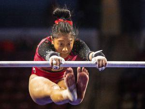 (Rick Egan | The Salt Lake Tribune) Alini Sabado competes on the uneven bars for Utah in the Best of Utah gymnastics meet at the Maverik Center on Saturday, Jan. 9, 2021.