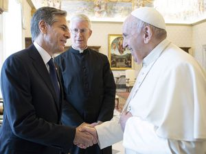 (Vatican Media via AP Photo) Pope Francis shakes hands with Secretary of State Antony Blinken as they meet at the Vatican, Monday, June 28, 2021. Blinken is on a weeklong trip in Europe, traveling to Germany, France and Italy.