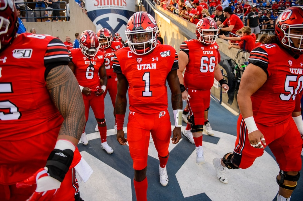 (Trent Nelson | The Salt Lake Tribune) ;Utah Utes quarterback Tyler Huntley (1) enters the stadium as Brigham Young University (BYU) hosts the University of Utah, NCAA football in Provo on Thursday Aug. 29, 2019.