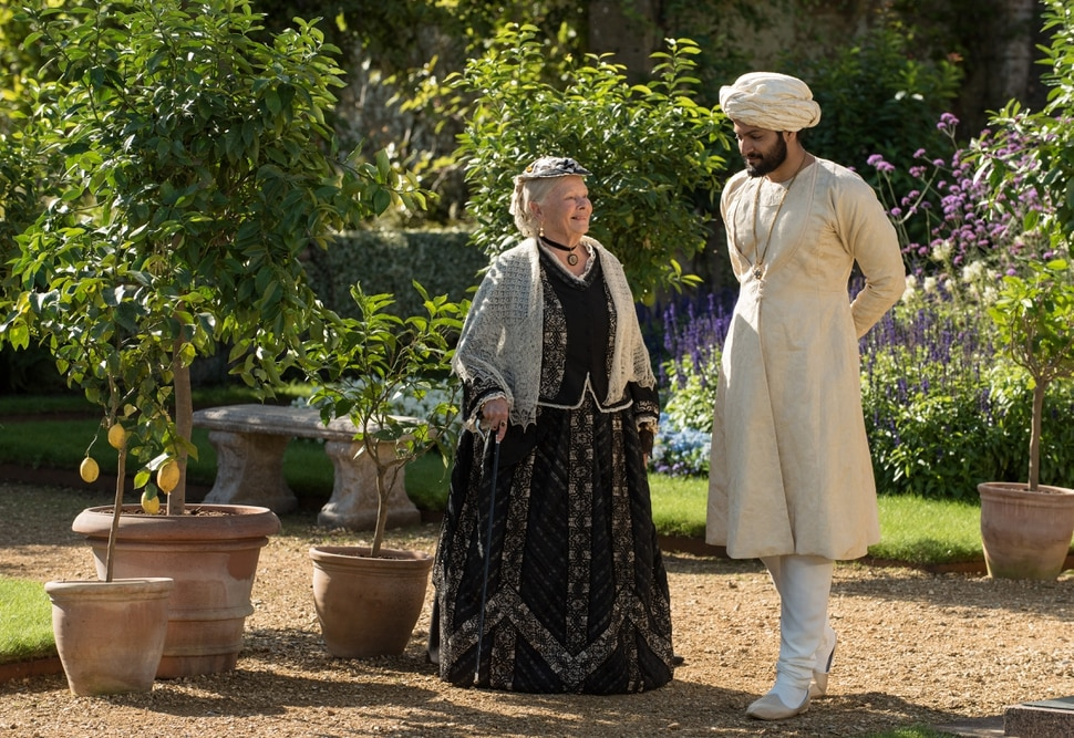 (Peter Mountain | courtesy Focus Features) Queen Victoria (Judi Dench, left) talks with Abdul Karim (Ali Fazal), an Indian Muslim who became her confidant in her final years, in director Stephen Frears' Victoria and Adbul.