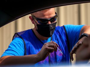 (Trent Nelson     The Salt Lake Tribune) Bryce Combe administers a dose of the Pfizer COVID-19 vaccine at a drive-thru event organized by the Utah County Health Department in Spanish Fork on Friday, Sept. 10, 2021.