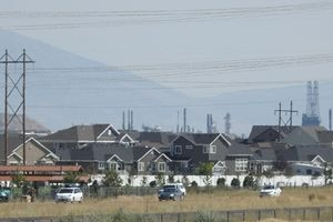 (Francisco Kjolseth |  Tribune file photo) Haze hangs over a North Salt Lake neighborhood in 2016. On Tuesday, the U.S. Environmental Protection Agency formally declared large portions of the Wasatch Front to be in violation of federal standards of ozone, a colorless, odorless airborne pollutant that can effectively burn sensitive lung tissues when inhaled.