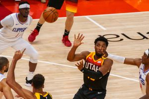 (Trent Nelson  |  The Salt Lake Tribune) Utah Jazz guard Donovan Mitchell (45) passes as the Utah Jazz host the Los Angeles Clippers in a Game 5 matchup, NBA basketball in Salt Lake City on Wednesday, June 16, 2021.