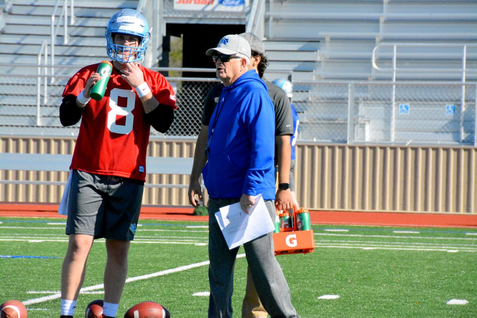 Photo courtesy Ben Platt/AAF | Salt Lake Stallions coach Dennis Erickson gives some advice to quarterback Allen Austin during preseason practice this past week in San Antonio. The Stallions open their inaugural season on Sunday in Phoenix against the Arizona Hotshots.