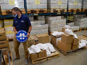 (Francisco Kjolseth     The Salt Lake Tribune) Granite School District communications director Ben Horsley overlooks PPE inventory being prepared to ship to schools for the start of classes next week from the Granite School District Warehouse on Tuesday, August 18, 2020.