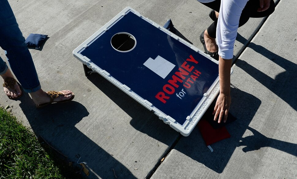 (Francisco Kjolseth | The Salt Lake Tribune) The Romney campaign hosts Mondays With Mitt at Veterans Memorial Park in West Jordan on Monday, June 18, 2018, as supporters play a friendly game of bean bag toss before the arrival of Senate candidate Mitt Romney with supporters at the park. .