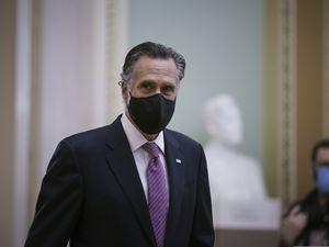 (J. Scott Applewhite | AP file photo ) Sen. Mitt Romney, R-Utah, returns to the Senate chamber during the impeachment trial of former President Donald Trump on Feb. 11, 2021.