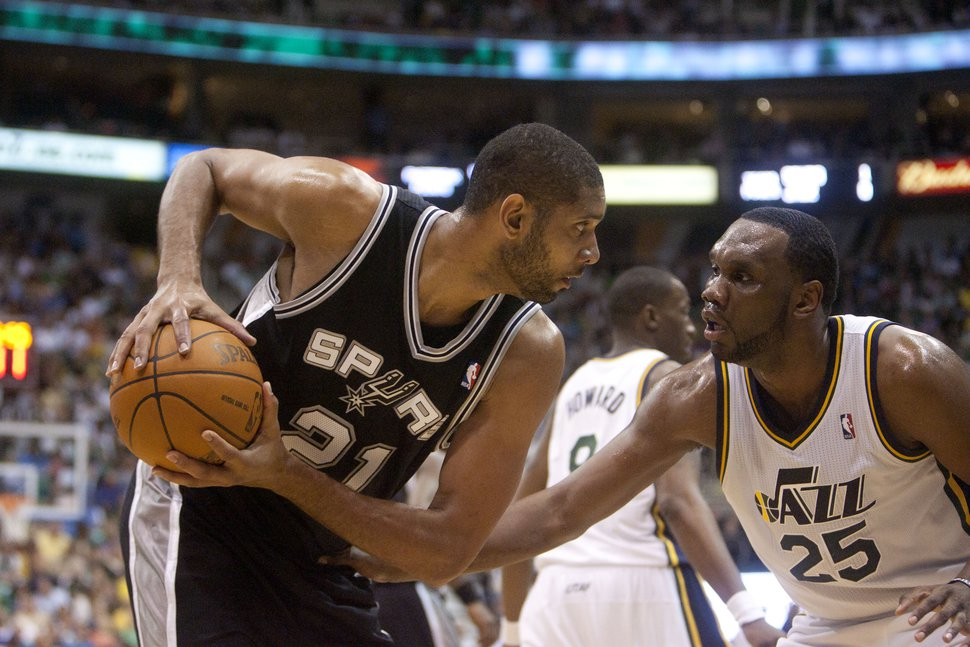 Jeremy Harmon | The Salt Lake Tribune Tim Duncan is defended by Al Jefferson as the Jazz host the Spurs in the first round of the NBA playoffs at EnergySolutions Arena in Salt Lake City, Saturday, May 5, 2012.