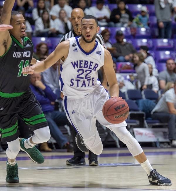 Rick Egan | The Salt Lake Tribune Weber State Wildcats guard Ryan Richardson (22) takes the ball inside, in basketball action, Weber State Wildcats vs Utah Valley Wolverines, in Ogden, Saturday, December 17, 2016.