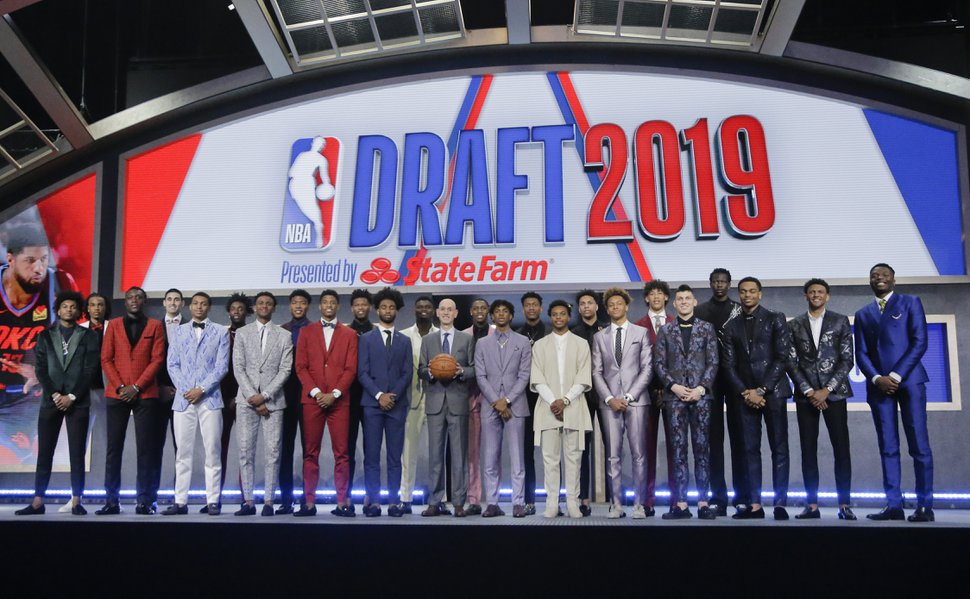 Prospective NBA draft picks pose for a group photo with NBA Commissioner Adam Silver, with basketball, before the NBA draft Thursday, June 20, 2019, in New York. (AP Photo/Julio Cortez)