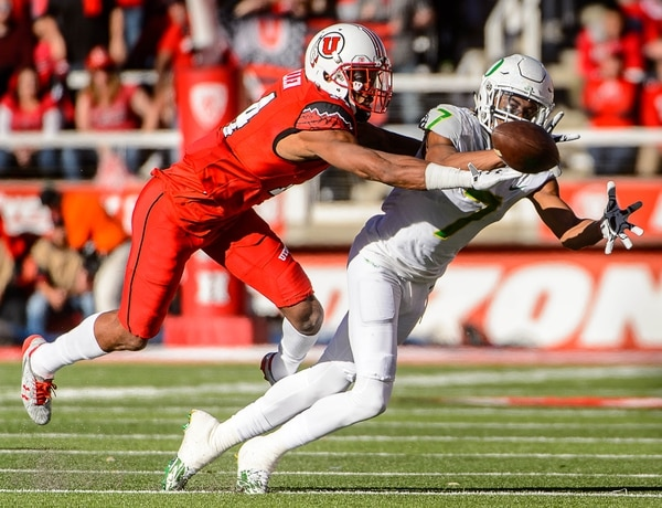 Trent Nelson | The Salt Lake Tribune Oregon Ducks wide receiver Darren Carrington II (7) dives unsuccessfully for a pass, with Utah Utes defensive back Brian Allen (14) defending as Utah hosts Oregon, NCAA football at Rice-Eccles Stadium in Salt Lake City, Saturday November 19, 2016.