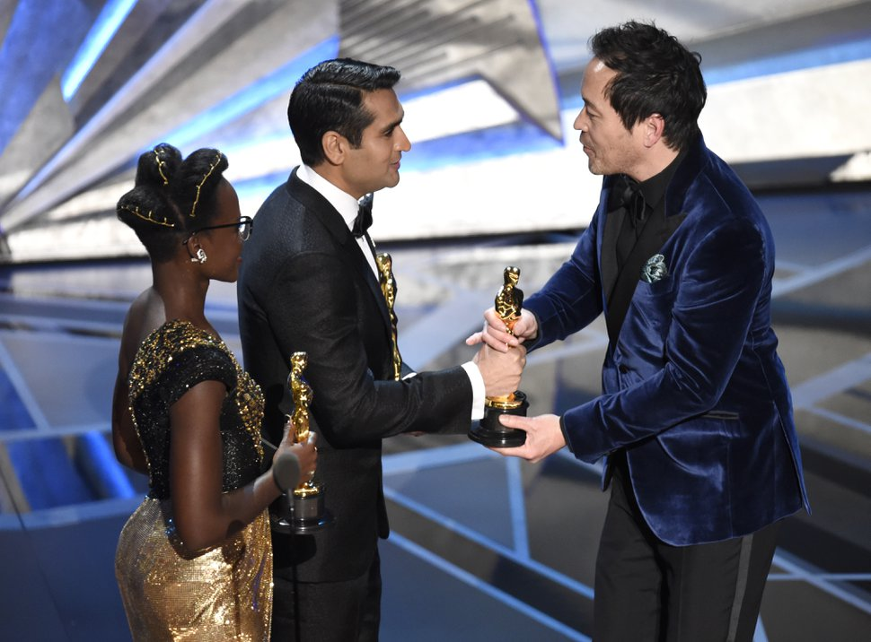 Lupita Nyong'o, from left, and Kumail Nanjiani present Paul Denham Austerberry the award for best production design for