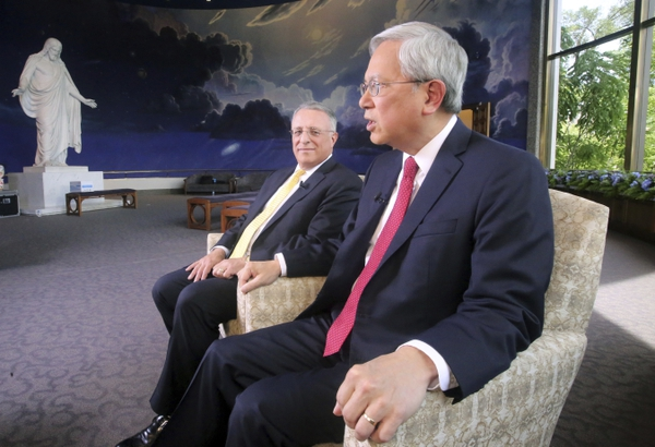 The two newest members of the LDS Quorum of the Twelve apostles, Elder Ulisses Soares, left, and Elder Gerrit W. Gong, right, speak on Thursday, June 28, 2018, in Salt Lake City, during their first media interviews since being appointed earlier this year. Soares and Gong made history by becoming the first-ever Latin American and the first-ever person of Asian ancestry on the previously all-white top leadership panel of The Church of Jesus Christ of Latter-day Saints. (AP Photo/Rick Bowmer)
