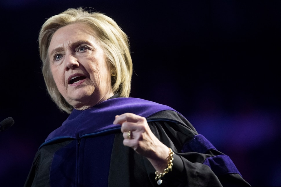 (Mary Altaffer | AP file photo) Former Secretary of State Hillary Clinton, seen here delivering a commencement address in May 2019 at New York's Hunter College, will appear at the 2020 Sundance Film Festival to promote the four-hour Hulu documentary series Hillary.