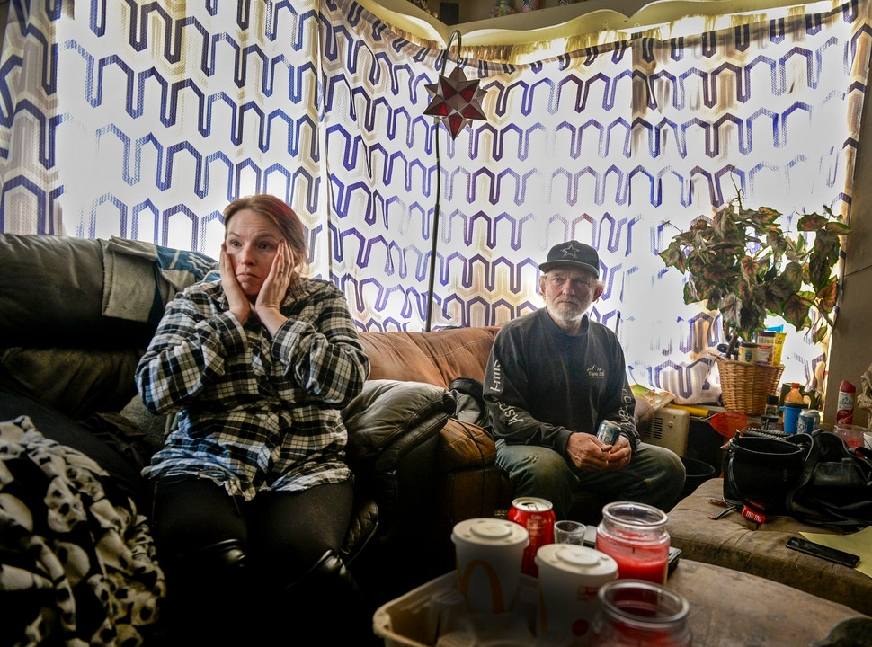 "(Leah Hogsten | The Salt Lake Tribune) ""I can't be approved for my next apartment by the time I need to be out,"" said Robert Gardner, right. On Monday, Gardner and his wife and three children — along with tenants in up to 42 other units at Georgia Apartments in Salt Lake City — were given three days to move out. City officials issued a ""red tag"" order to the building's landlord after multiple requests to bring the building up to code went unheeded."