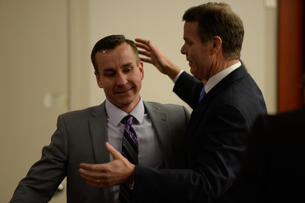 Francisco Kjolseth | The Salt Lake Tribune Former Utah Attorney General John Swallow hugs defense attorney Brad Anderson after he was cleared of all charges during his public-corruption trial in Salt Lake City, Thursday March 2, 2017.