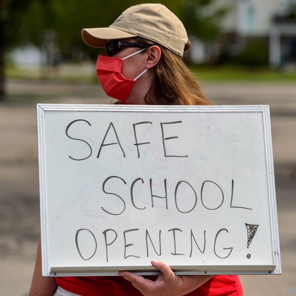 (Trent Nelson | The Salt Lake Tribune) Elizabeth Pickett, a teacher at Westvale Elementary School, joined other teachers and parents holding signs calling for a safe plan on reopening schools prior to a Jordan School District board meeting in Riverton on Tuesday, July 28, 2020.