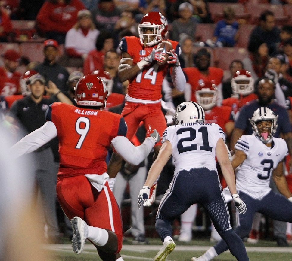 BYU's Talon Shumway, center, watches Fresno State's Jaron Bryant intercept a pass that was called back due to a penalty during the first half of an NCAA college football game in Fresno, Calif., Saturday, Nov. 4, 2017. (AP Photo/Gary Kazanjian)