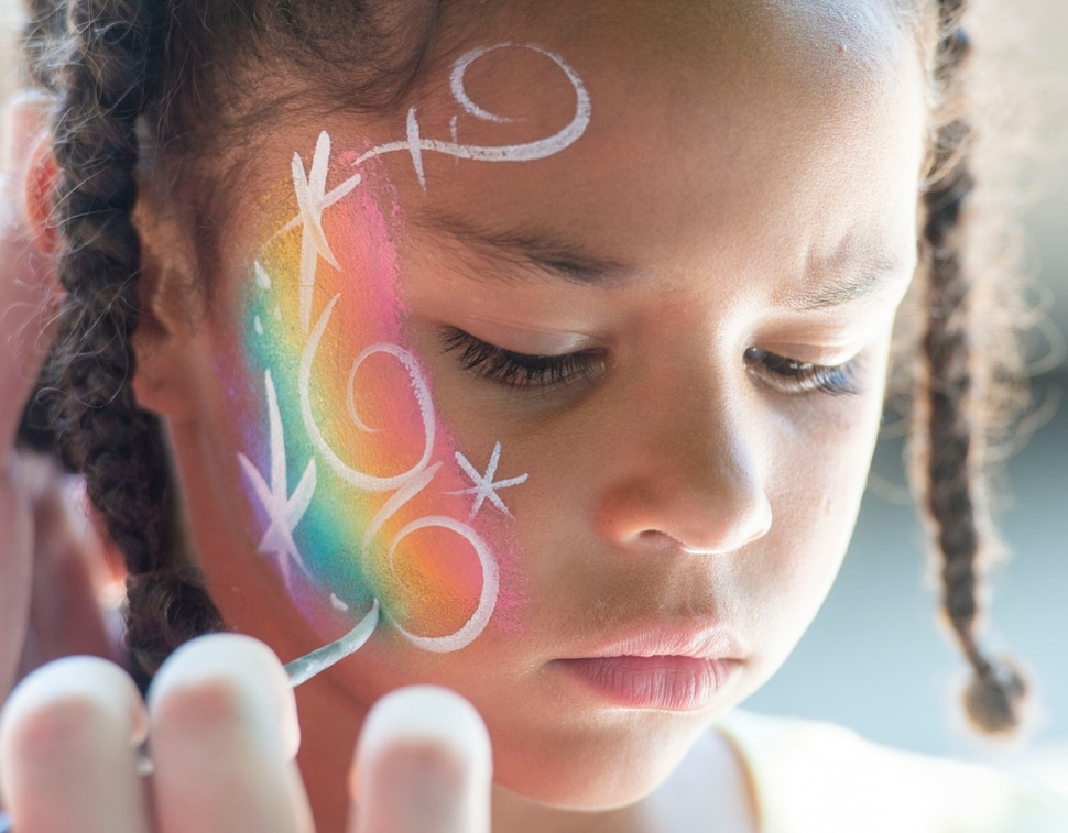 (Rick Egan | The Salt Lake Tribune) Ava Stevenson 6, has her face painted at the Juneteenth festival at the Ogden Amphitheater, Saturday, June 15, 2019.