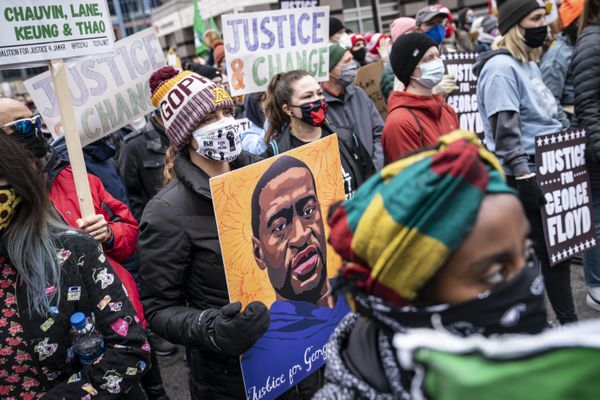Demonstrators gather during a rally outside the Hennepin County Government Center before the murder trial against former Minneapolis police Officer Derek Chauvin in the killing of George Floyd advances to jury deliberations, Monday, April 19, 2021, in Minneapolis. (AP Photo/John Minchillo)