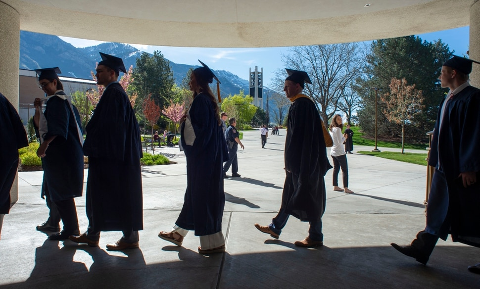 (Rick Egan | The Salt Lake Tribune) Brigham Young University Graduates make their way to the Marriott Center for the 144th BYU Commencement, Thursday, April 25, 2019.