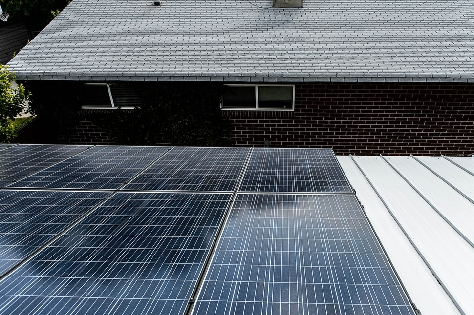 (Trent Nelson | The Salt Lake Tribune) Solar panels on the roof of Erin and Ray Searles's Rose Park home, Friday August 4, 2017. Rocky Mountain Power has proposed a new rate schedule for customers with solar panels. The proposal would disproportionately impact low- and moderate-income households while giving wealthier households a break.